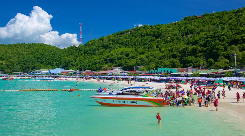 Ta-Yai Beach featuring boating and a sandy beach as well as a large group of people