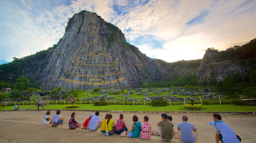 Buddha Mountain featuring religious elements and mountains as well as a large group of people