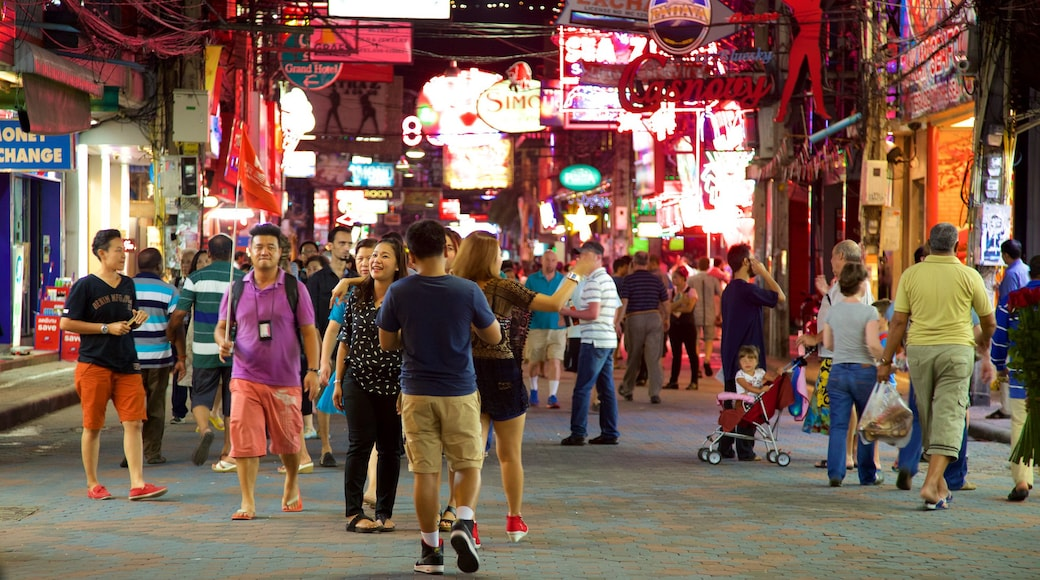 Walking Street featuring night scenes and markets as well as a large group of people