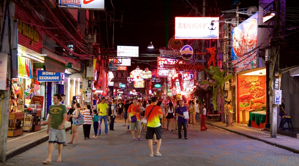 Walking Street which includes night scenes and markets as well as a large group of people