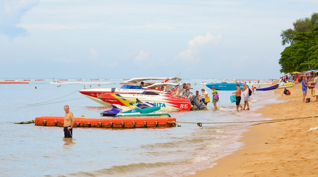 Jomtien Beach featuring boating and a sandy beach as well as a large group of people