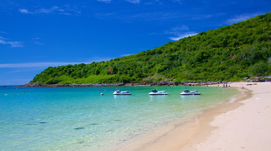Nual Beach which includes a sandy beach and jet skiing