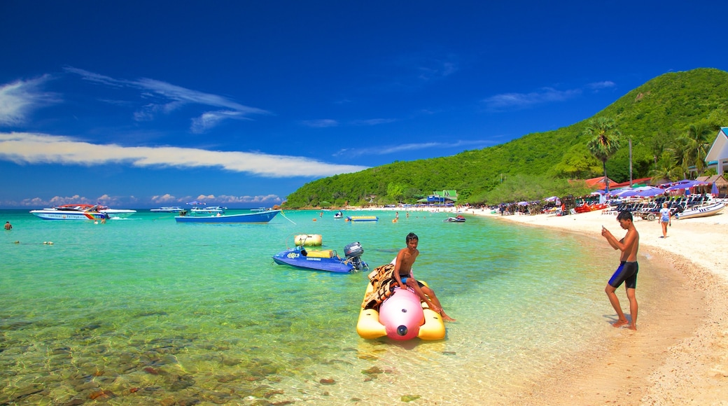 Koh Lan featuring boating and general coastal views as well as children