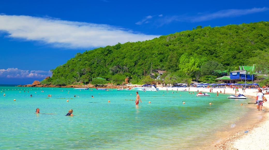 Koh Lan which includes general coastal views, swimming and a bay or harbor