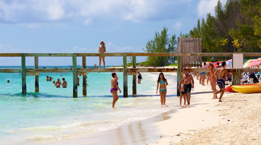 Taino Beach showing a beach and general coastal views as well as a large group of people