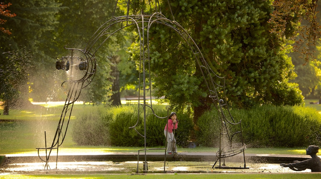 Christchurch Botanic Gardens featuring a fountain and a park as well as an individual child