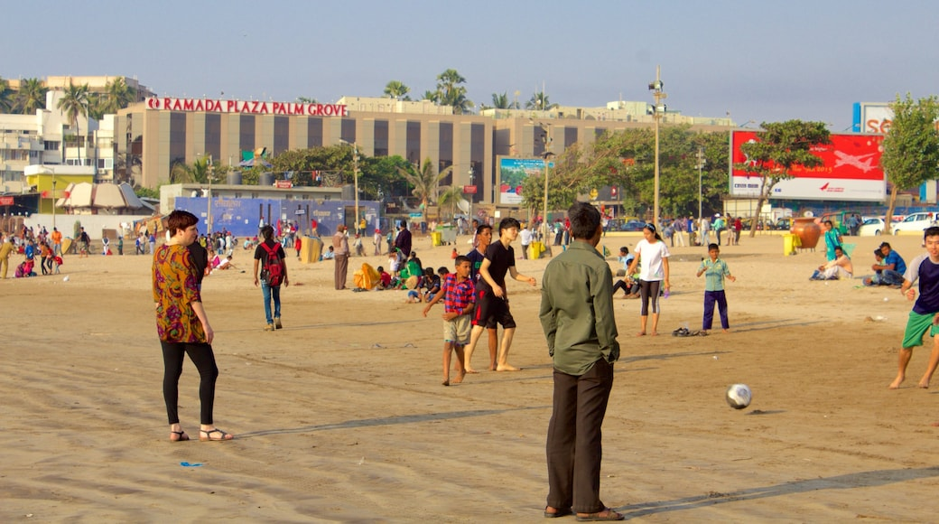 Juhu Beach which includes general coastal views as well as a large group of people