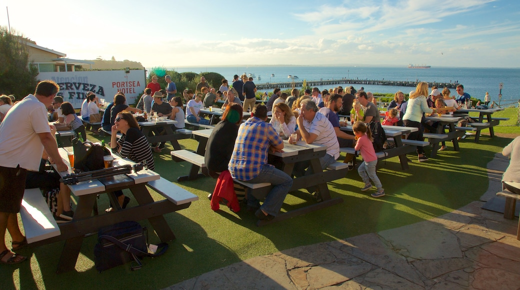 Portsea which includes outdoor eating as well as a large group of people