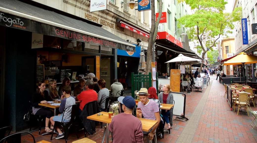 Hardware Lane which includes cafe lifestyle and outdoor eating as well as a large group of people