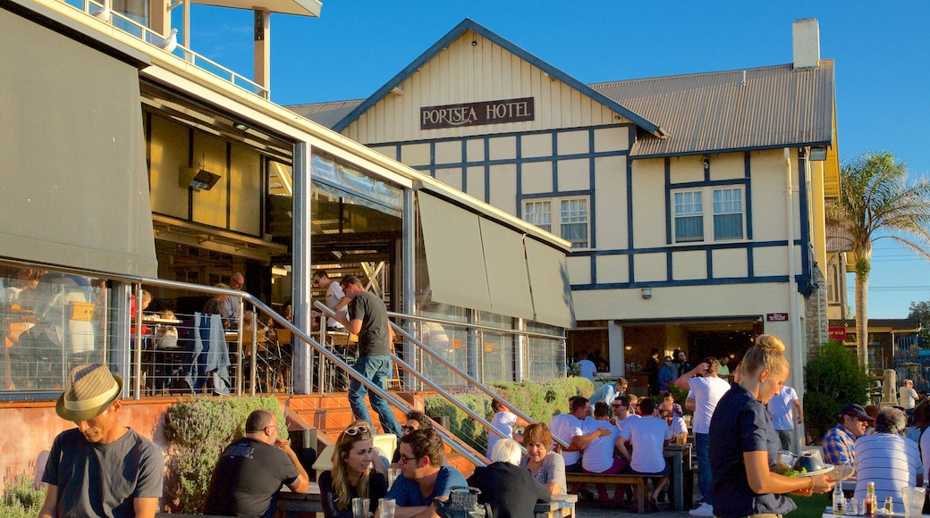 Portsea which includes dining out and outdoor eating as well as a large group of people