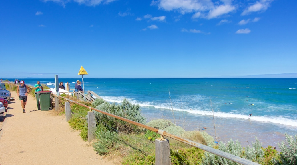 Torquay which includes general coastal views as well as a small group of people