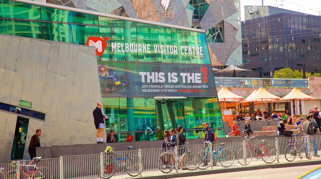 Federation Square which includes a square or plaza as well as a large group of people