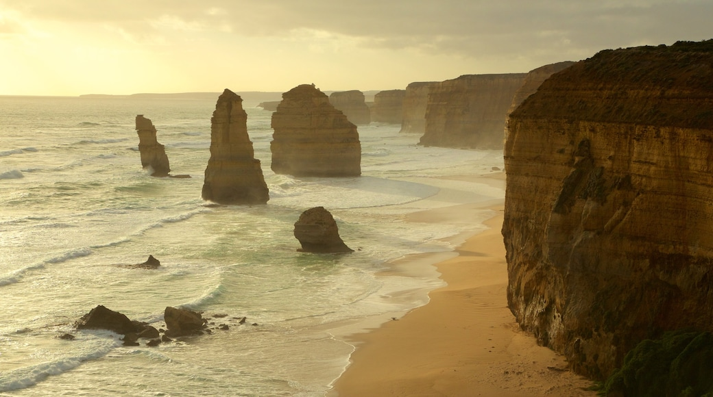 Twelve Apostles which includes rocky coastline, a gorge or canyon and a sunset
