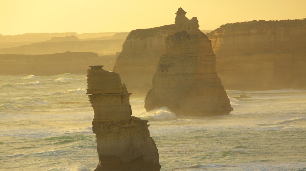Twelve Apostles showing general coastal views and a sunset