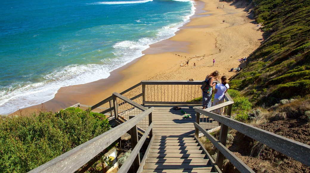 Bell\'s Beach showing a beach and views as well as a small group of people