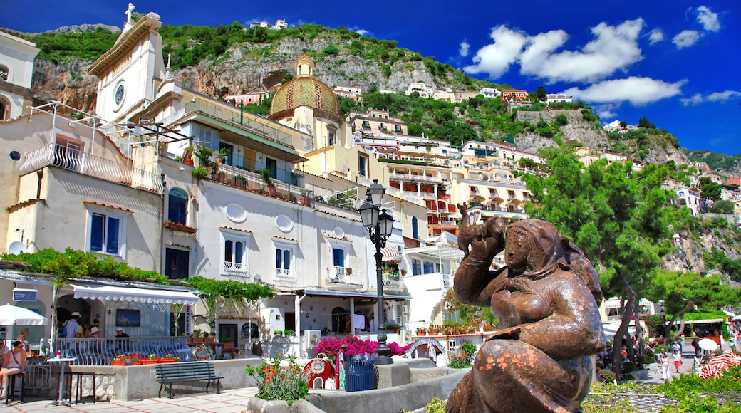Positano featuring a coastal town and a statue or sculpture