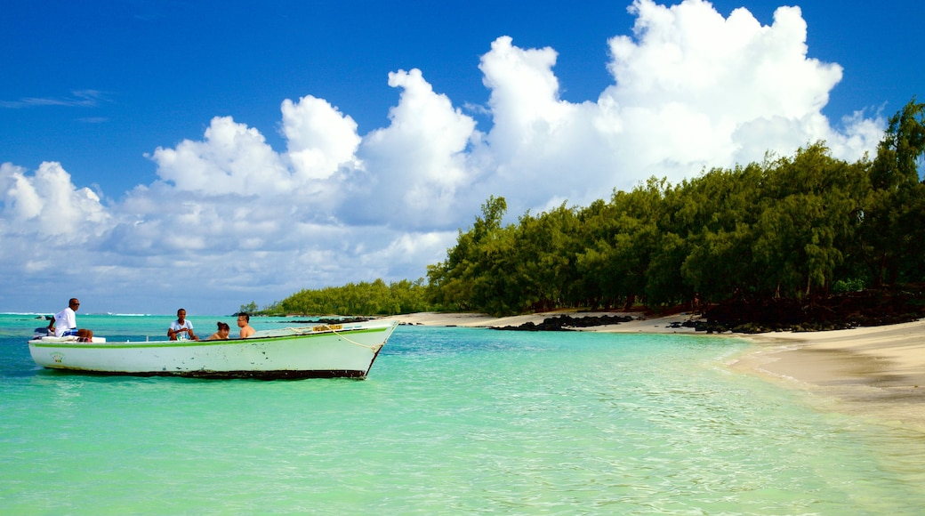 Ile aux Cerfs Beach featuring a sandy beach and boating as well as a small group of people