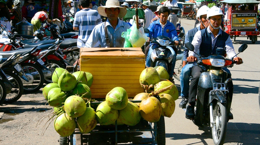 Kandal Market featuring food and motorcycle riding as well as a small group of people