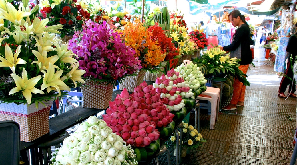 Central Market featuring markets and flowers as well as an individual femail