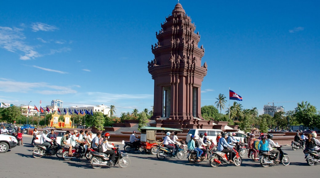 Independence Monument featuring motorbike riding and a monument