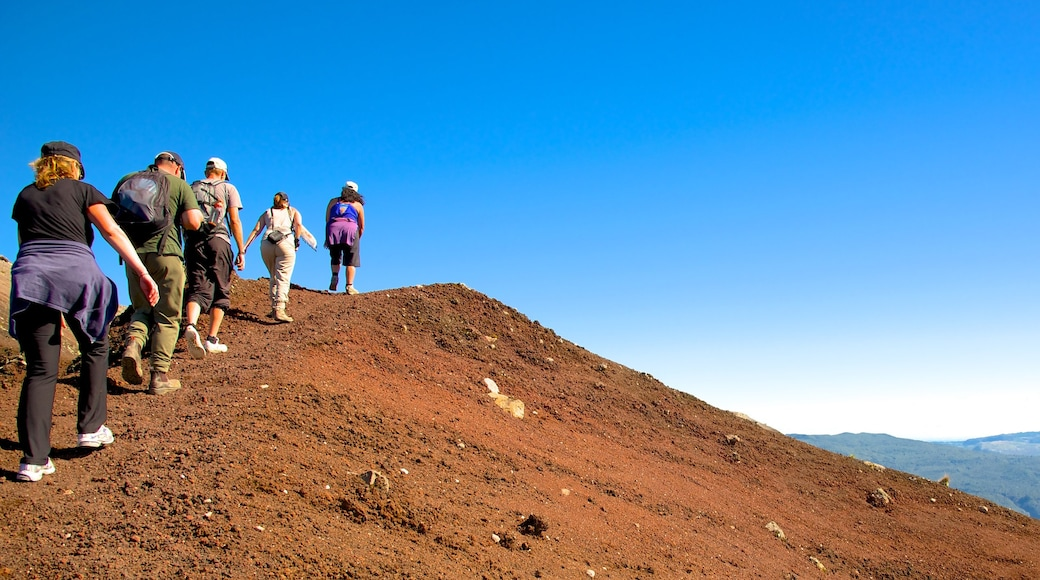 Mount Tarawera showing hiking or walking and tranquil scenes as well as a small group of people