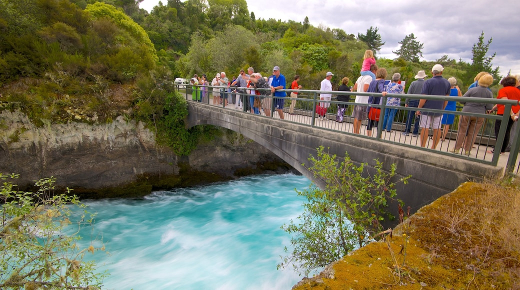 Huka Falls which includes a bridge and rapids as well as a large group of people
