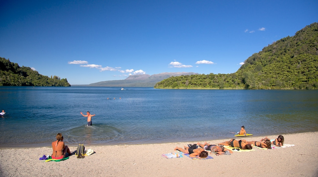 Lake Tarawera which includes swimming and a beach as well as a small group of people