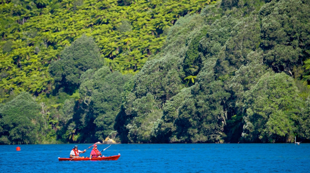 Lake Tarawera showing a lake or waterhole and kayaking or canoeing as well as a small group of people