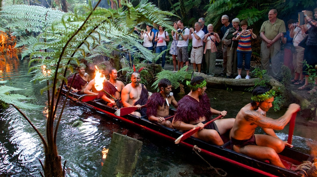 Rotorua showing a river or creek and indigenous culture as well as a small group of people