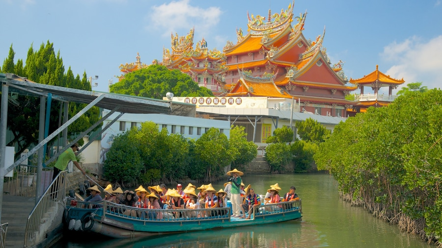 Taijiang National Park which includes a ferry, a river or creek and a temple or place of worship