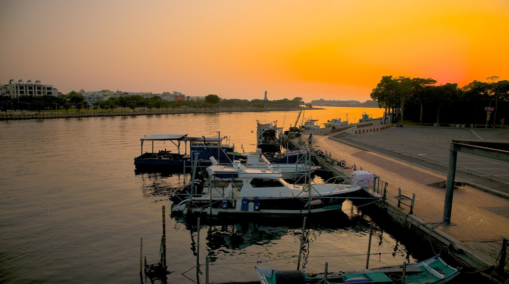 Anping Harbor which includes a bay or harbour and a sunset