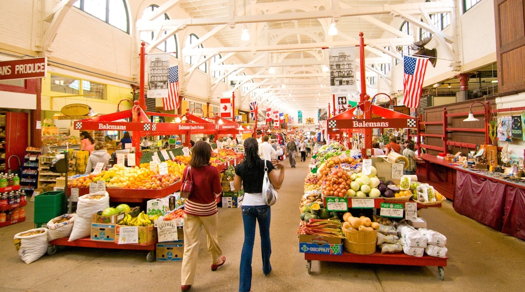 Saint John featuring markets and interior views as well as a small group of people