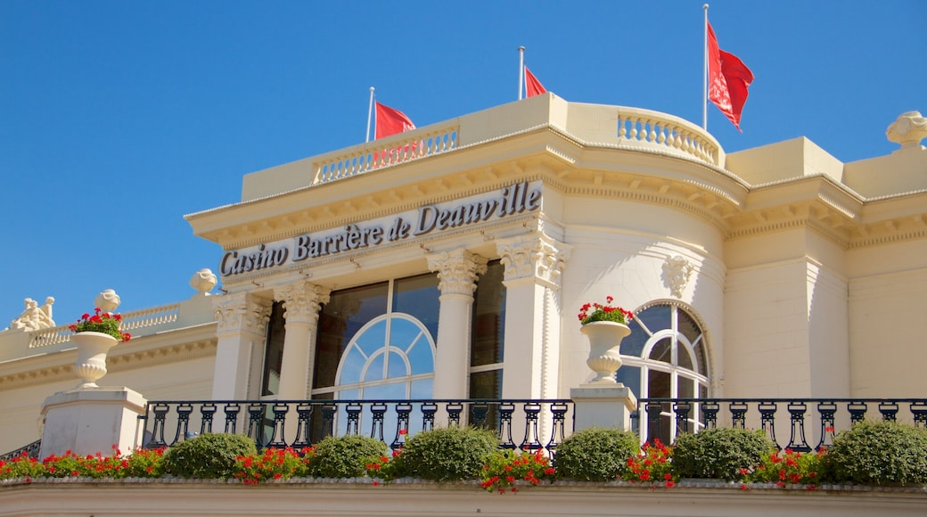 Deauville featuring flowers, a casino and signage