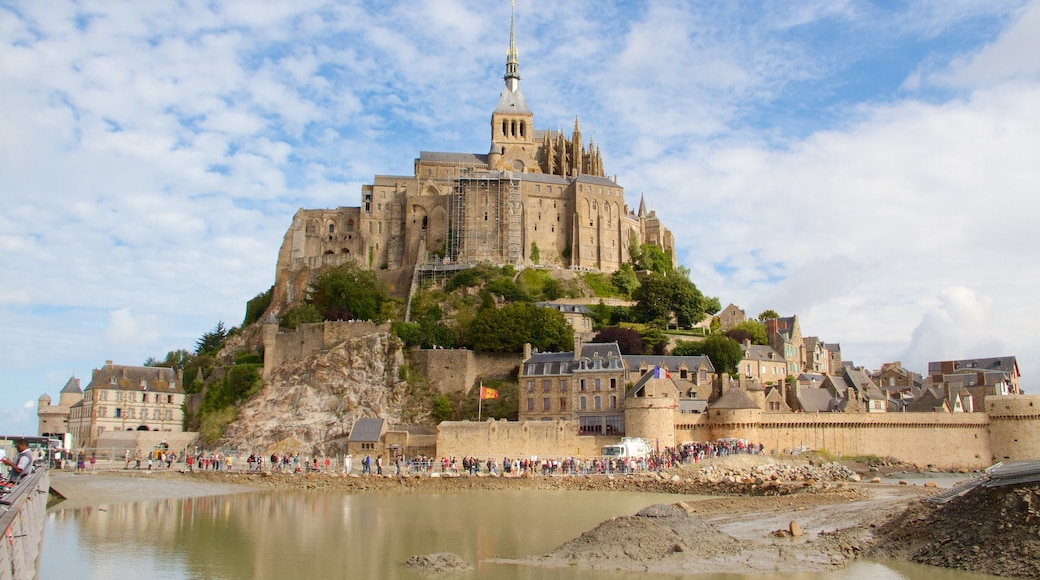 Le Mont-Saint-Michel which includes a small town or village, a castle and heritage elements