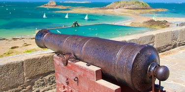 St. Malo Beach which includes heritage elements, a bay or harbour and general coastal views