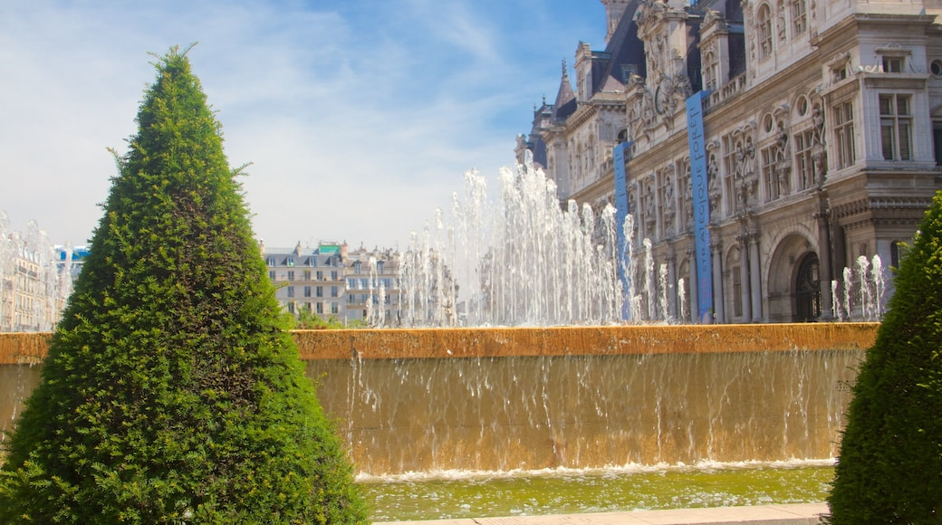 Hotel de Ville which includes heritage architecture, a fountain and a garden