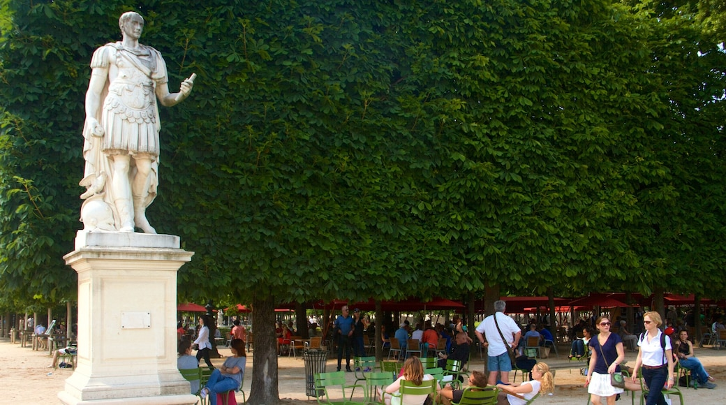 Tuileries Garden showing a statue or sculpture and a park as well as a small group of people