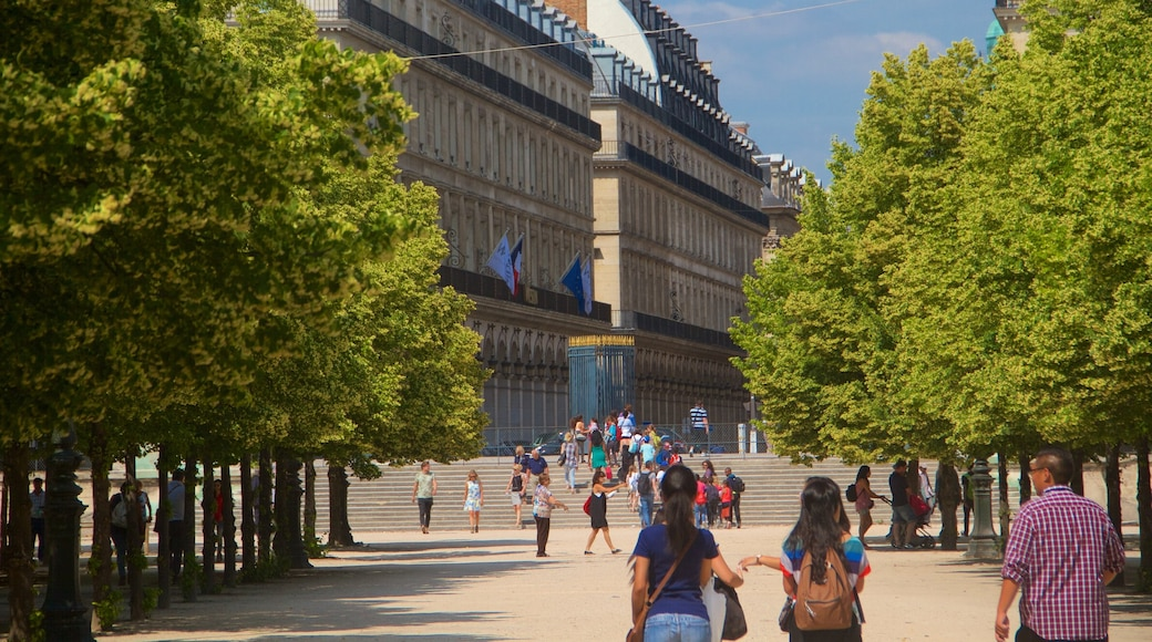 Tuileries Garden featuring a city as well as a small group of people