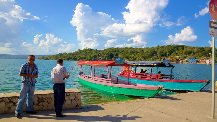 Flores featuring fishing and general coastal views as well as a small group of people