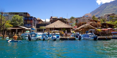 Santiago Atitlan featuring a coastal town and a bay or harbour