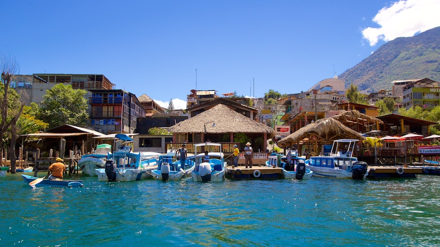 Santiago Atitlan showing a coastal town and a bay or harbor
