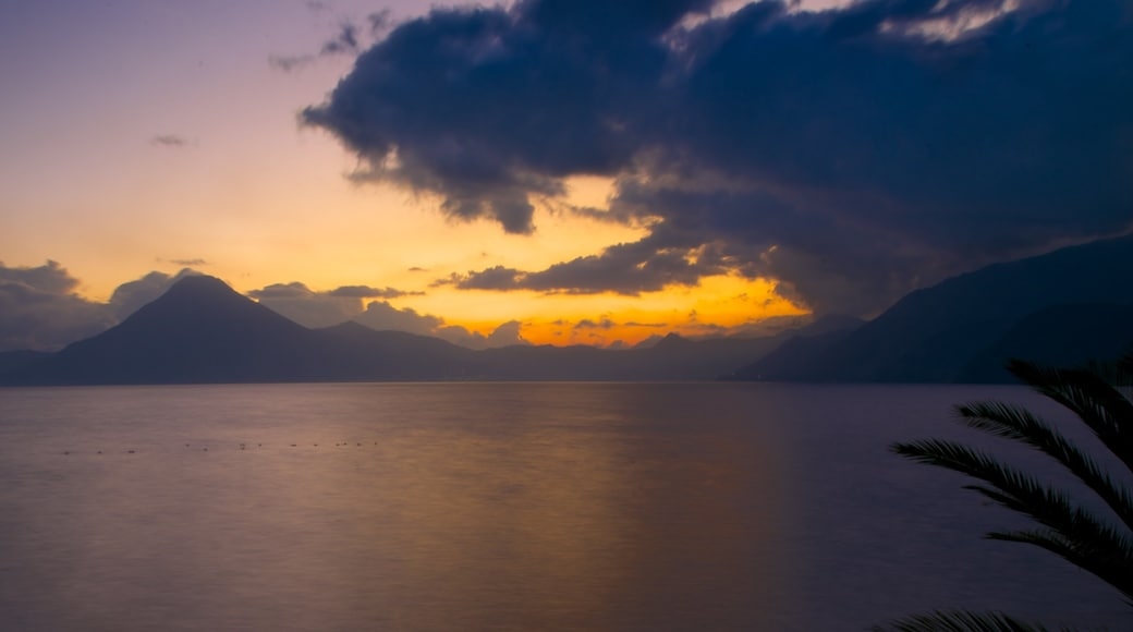 Atitlan Volcano showing a sunset, general coastal views and mountains