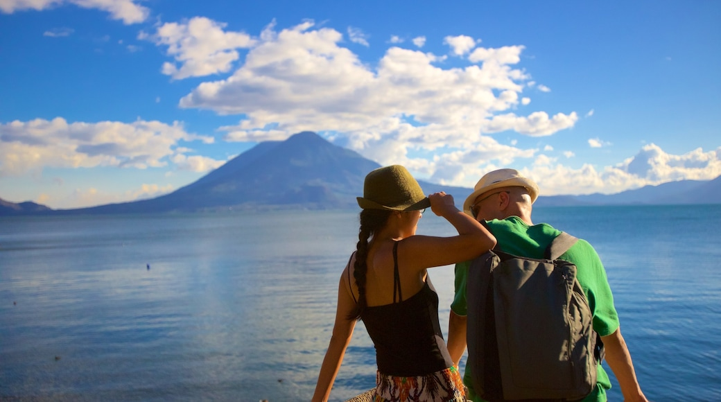 Atitlan Volcano showing mountains and general coastal views as well as a couple