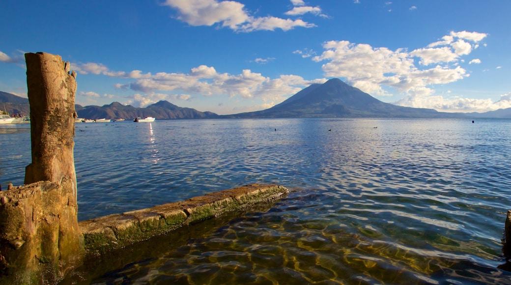 Atitlan Volcano featuring a bay or harbor, mountains and general coastal views