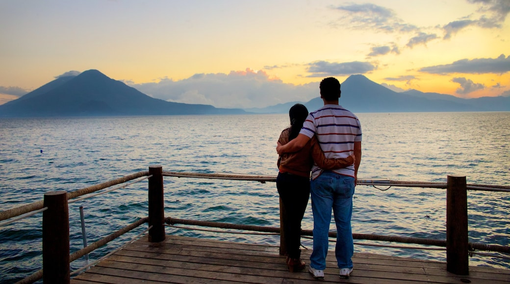 Atitlan Volcano featuring general coastal views, mountains and a sunset
