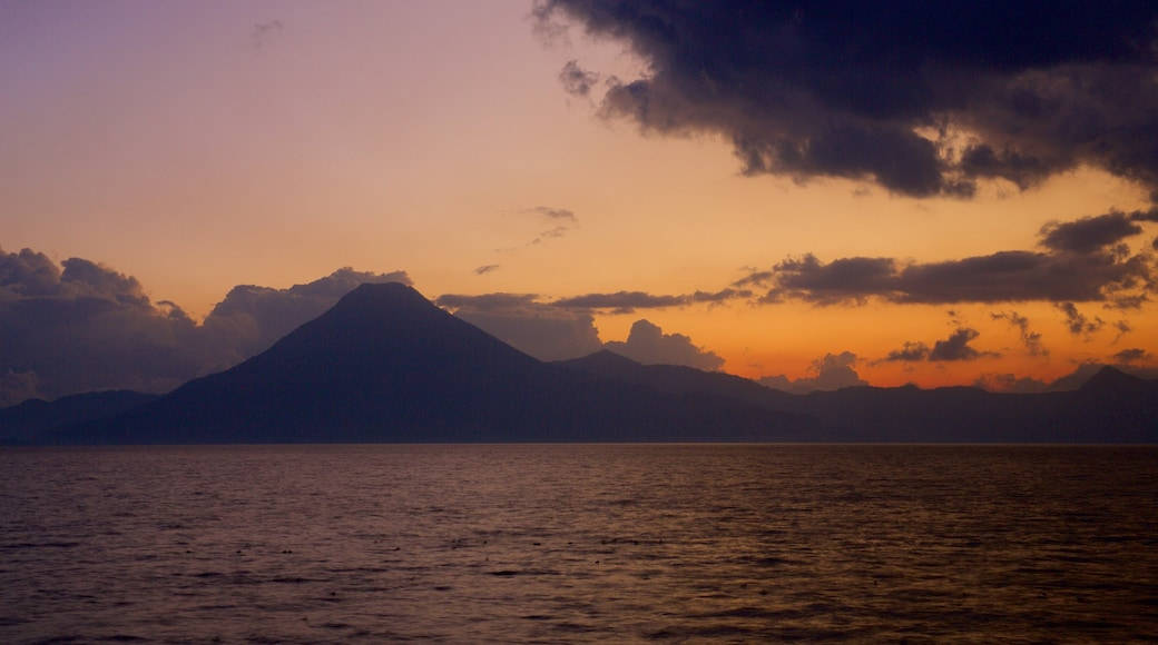 Atitlan Volcano featuring mountains, a sunset and general coastal views