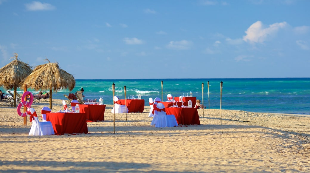 Uvero Alto featuring a sandy beach, dining out and a luxury hotel or resort