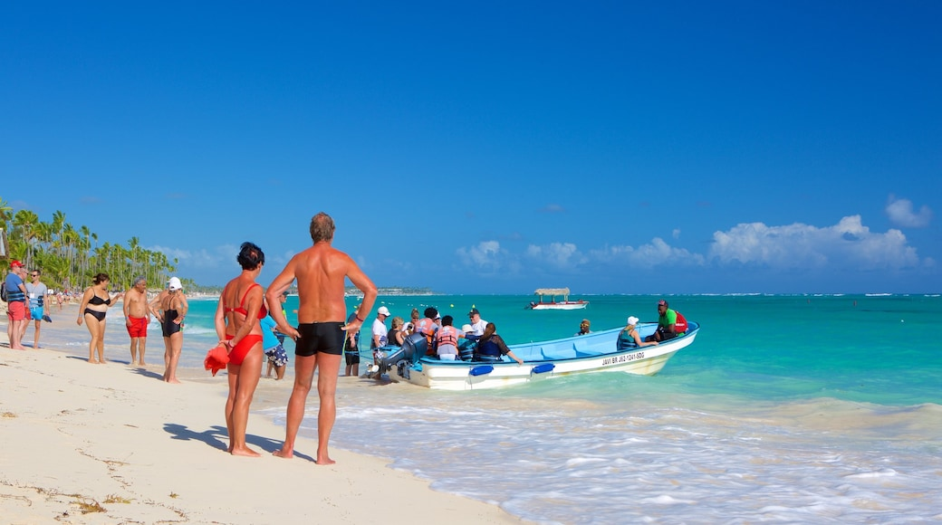 Cortecito Beach showing a sandy beach as well as a small group of people
