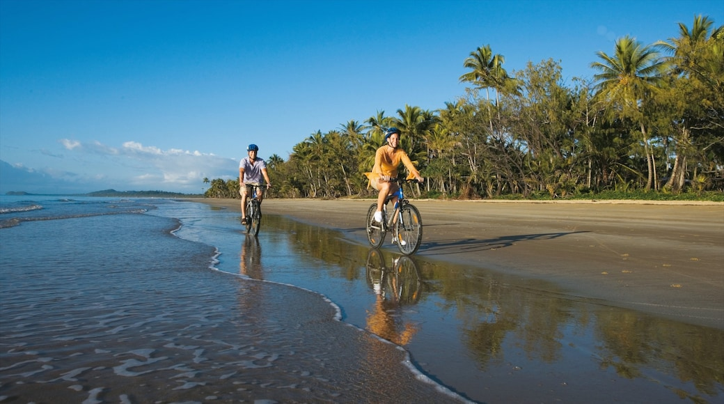 Mission Beach showing a sandy beach and mountain biking as well as a small group of people