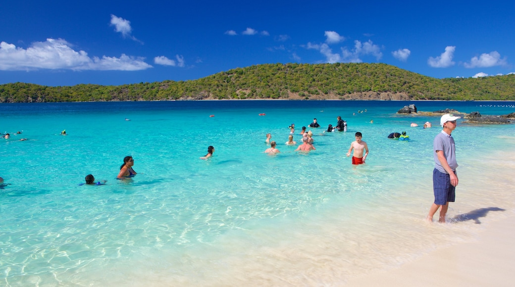 Coki Beach showing a sandy beach as well as a small group of people